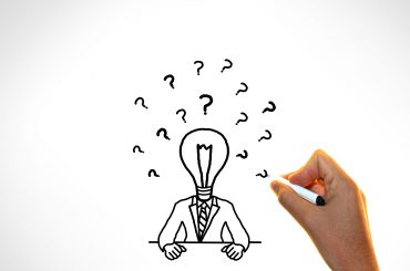 Doubts and ideas concept -  Businessman with questions marks