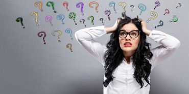 Question Marks with woman feeling stressed